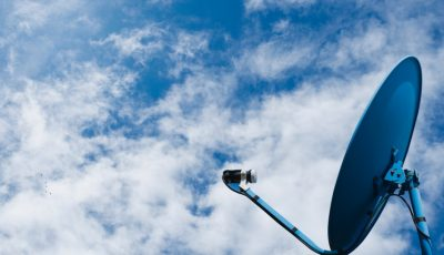 network-from-satellite-dish-on-blue-sky-background-picture-id932744126